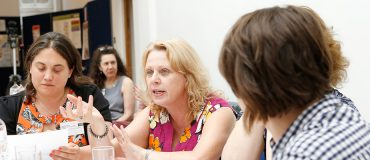 Women in discussion at a conference