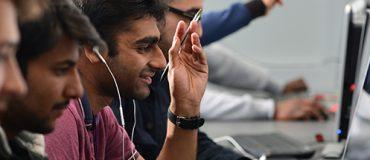 Men looking at computer screens