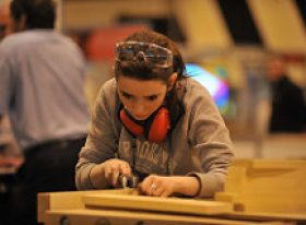 Female cabinet making apprentice