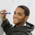 boy writing on a whiteboard