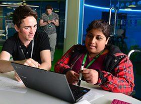 Male teacher with female SEND learner in wheelchair
