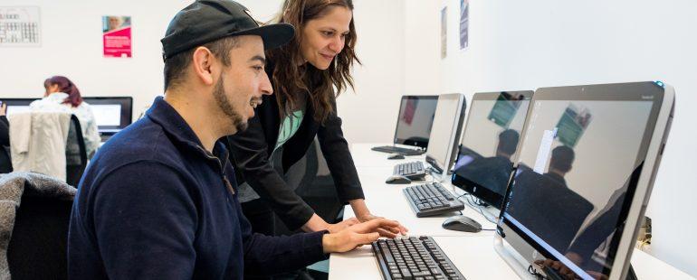 Man and woman using computer