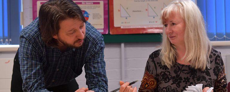 Female adult learner and male teacher
