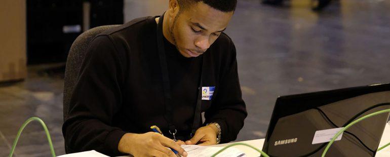 male apprentice writing