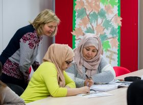 Female teacher and female learners