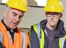 male construction teacher and learner