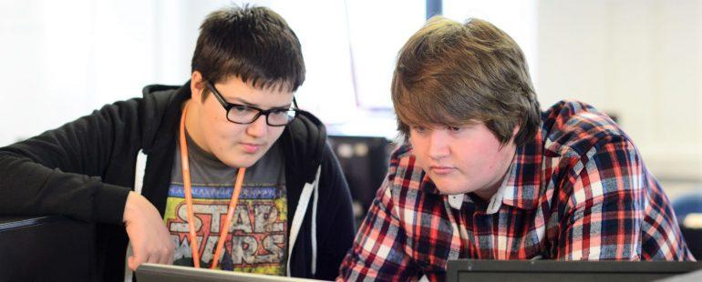 Students collaborating at computer screen