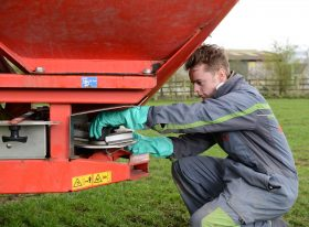 Apprentice maintaining agricultural machinery