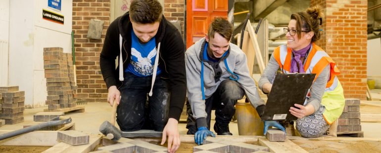 Construction students laying flooring