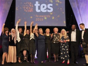 Winners of Overall Provider of the Tear celebrating with ETF Chief Exec David Russell