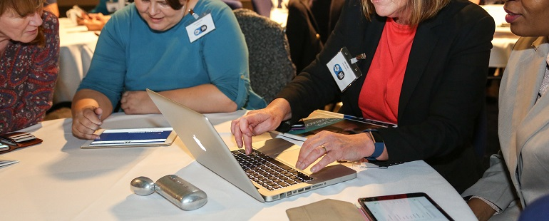 ladies using iPad and laptop at SET conference
