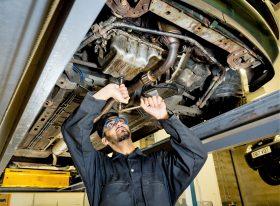 Mechanic working under a car