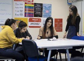 Female teacher with 3 female students