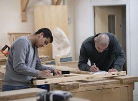 Carpentry student and teacher