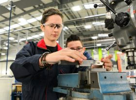 Female and male apprentices in workshop