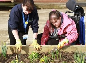 gardening teacher with learner with SEND