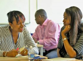 Middle managers in conversation at event