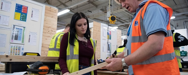 carpentry teacher with female student