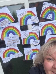 image of Sarah Le Good with drawings of rainbows