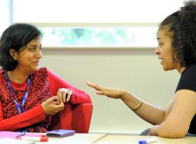 Two teachers in conversation