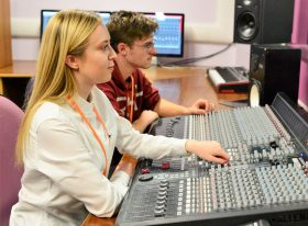 Two students at mixing desk