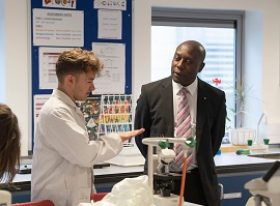 learner with college governor in lab