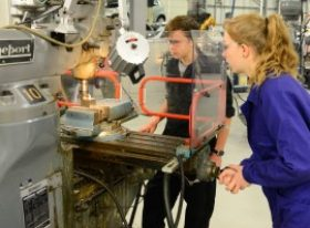 Students working at machinery in workshop