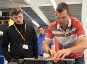 Teacher and student in workshop