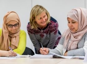Teacher in discussion with two students