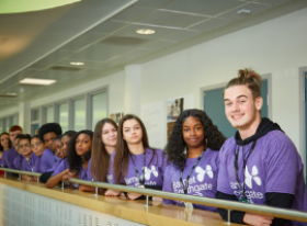 Group of pupils wearing purple t-shirts with the Barnet and Southgate College logo
