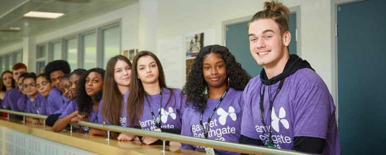 Group of pupils wearing a purple tshirt with the Barnet and Southgate College logo
