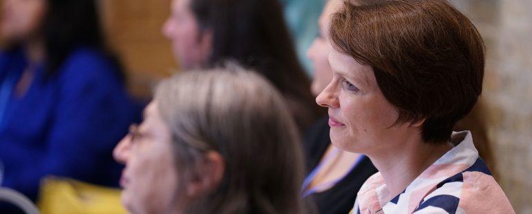 Women listening to a speech